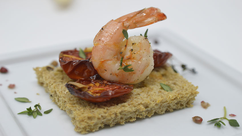 Roasted tomatoes and shrimps bruschetta